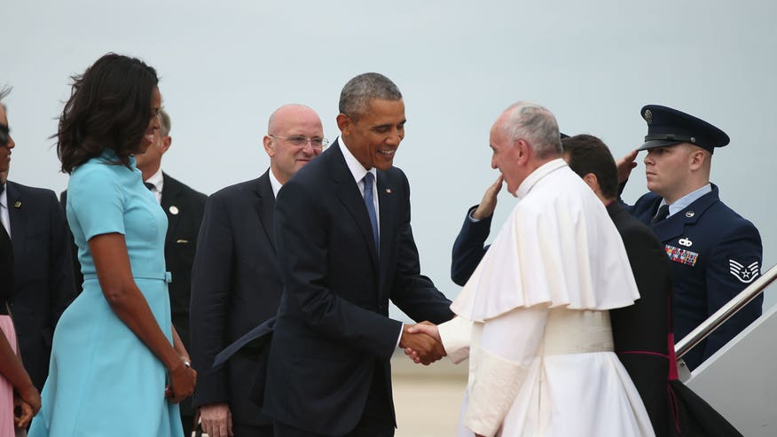 Pontiff is greeted by President Obama at Joint Base Andrews