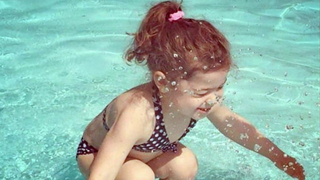 Puzzling picture: Is the girl in this photo underwater?