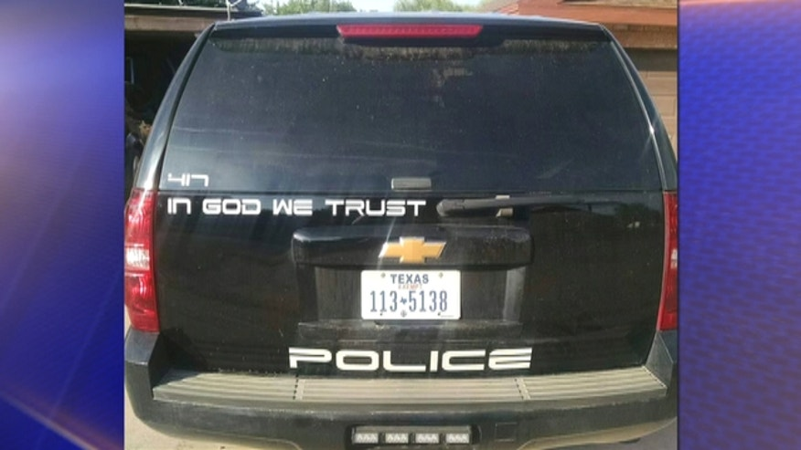 Childress Police Chief Adrian Garcia came under fire for 'In God We Trust' decals he placed on patrol cars.
