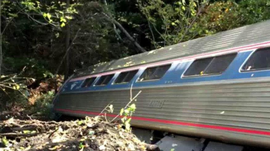 Report: 'Vermonter' hit rockslide sending cars down steep embankment