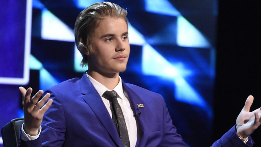 Break Time: Bieber may not sue because pics portray him in flattering light