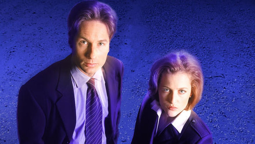 FOX411 goes to New York Comic Con. David Duchovny reveals that an 'X-Files' reboot is perfect in today's 'paranoid' society