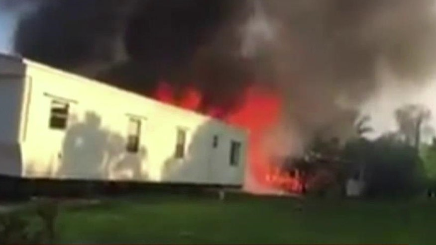 Plane crashed in mobile home park, setting two homes on fire