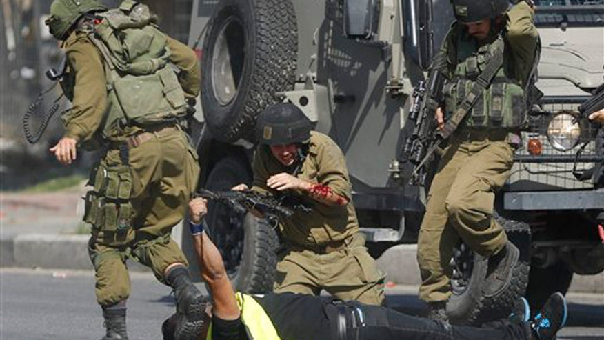Or Heller reports on latest attack against Israeli soldiers at checkpoint