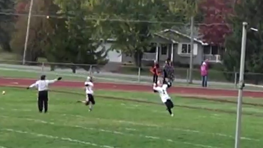 Raw video: High school football player in New York penalized for religious gesture