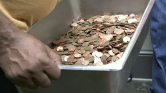 Penny pinching pays off! Man cashes in $5000 in coins