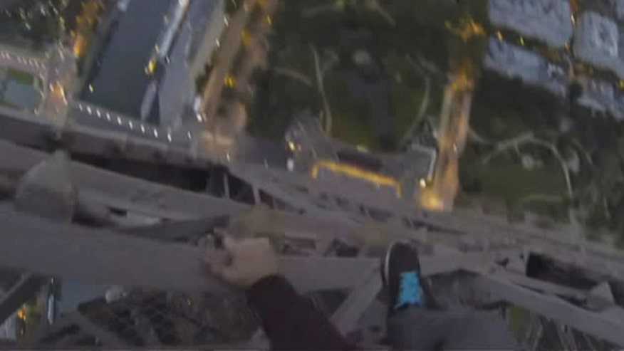 Daring late-night ascent of French landmark caught on tape