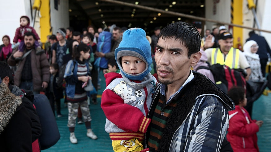 States pushing back amid concerns of background checks on Syrian refugees