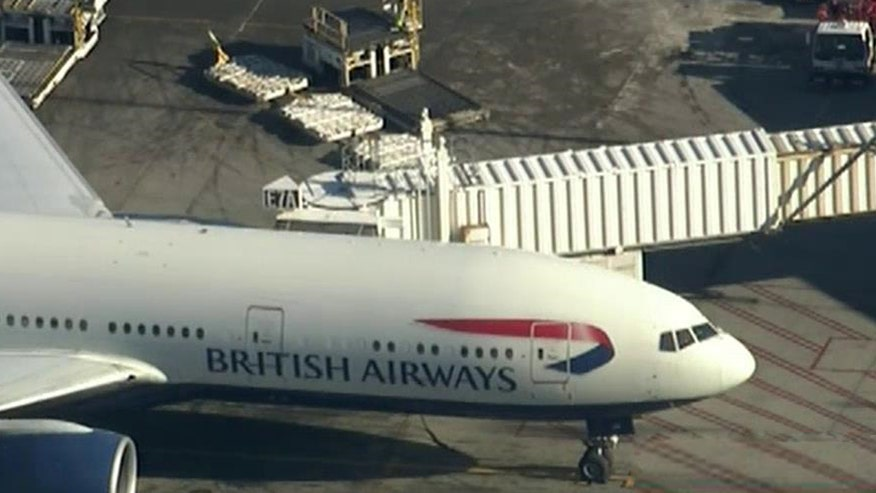 Police meet British Airways flight in Boston