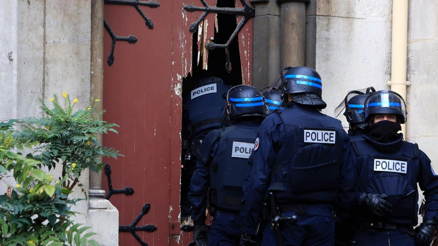 Two dead, seven arrested in raid in the French suburb of St. Denis