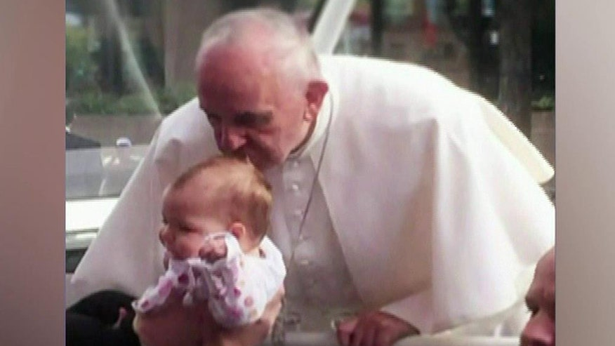 Pope Francis spontaneously kissed the one-year-old while visiting Philadelphia