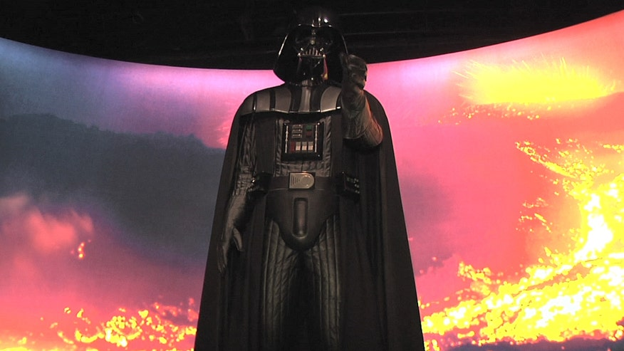 Fans flock to the new Times Square 'Star Wars' costume exhibit that features pieces from all six movies and a few surprises from 'The Force Awakens'