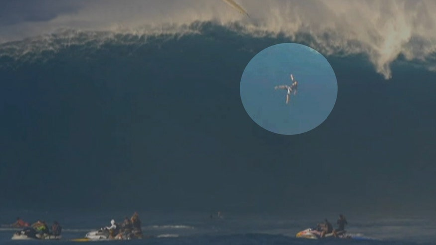 Raw video: Professional Tom Dosland is caught on camera during a scary freefall from a huge wave in Maui, Hawaii. Video courtesy of WorldSurfLeague.com