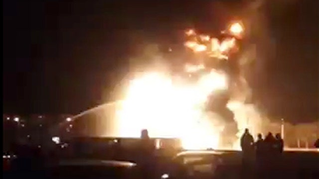 Gas station explodes as firefighters battle blaze