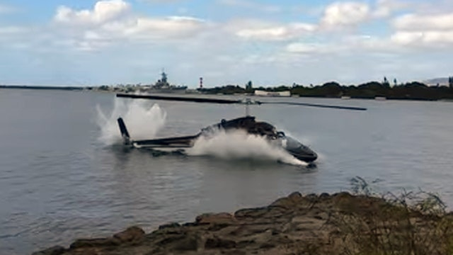 Watch as tourist helicopter crashes into Pearl Harbor