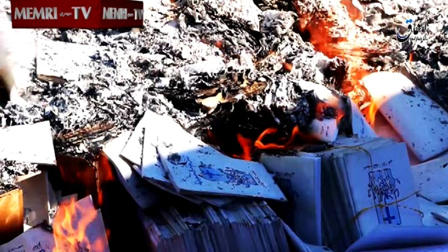 Raw video: Terror group destroys textbooks in Iraq