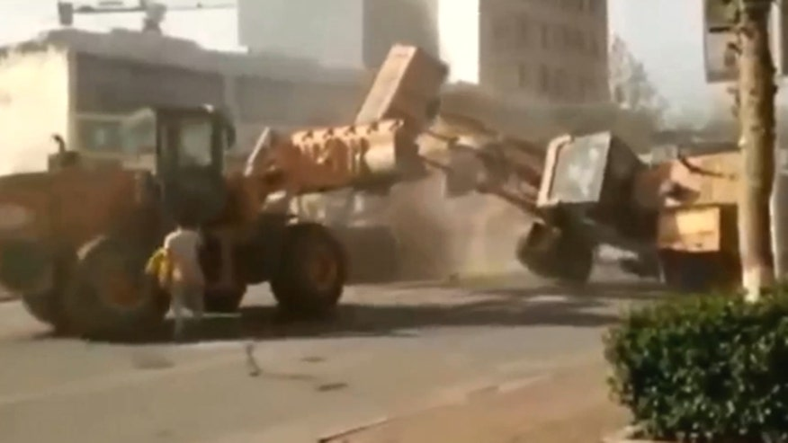 Raw video: Police in northern China say an argument between construction workers escalated into a demolition derby