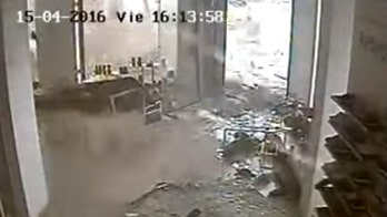 Raw video: Surveillance video captures storm ripping apart store