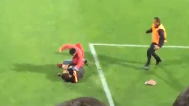 Chaos on the pitch: Fan invades field, attacks referee