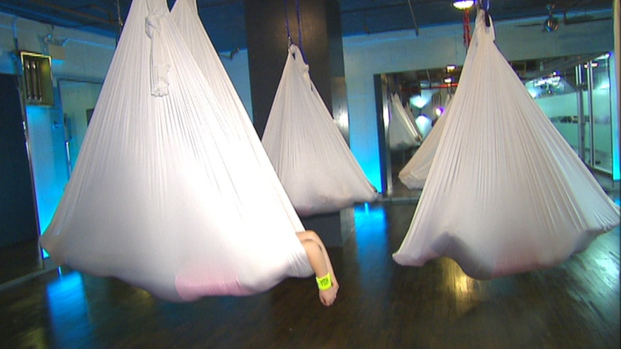 If you just can't get into meditation, perhaps anti-gravity cocooning is for you. The Crunch Gym class incorporates meditation while hanging from a hammock for weightless relaxation