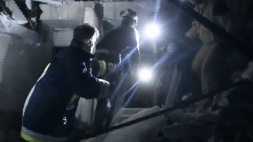 Rescue team searches the rubble for survivors