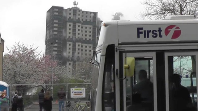 Whoops! Bus photobombs high-rise demolition