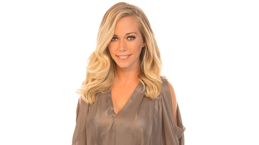 """Kendra on Top"" reality star Kendra Wilkinson says she doesn't appreciate how her former ""Girls Next Door"" housemate Holly Madison depicted her time at the Playboy Mansion."