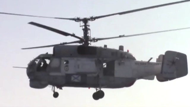 Russian chopper circles US missile destroyer
