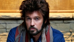 "Billy Ray Cyrus stars in the new CMT comedy ""Still the King"" playing a character named ""Burnin' Vernon"" a former country star turned Elvis impersonator who tries to get out of community service by pretending to be the new minister in a town."
