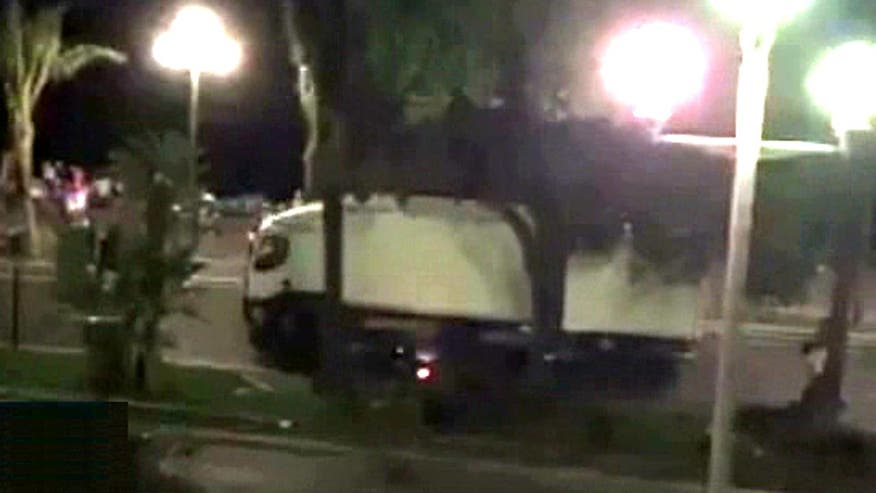 Raw video: Law enforcement officers seen shooting at truck's cab before truck barrels toward Bastille Day revelers