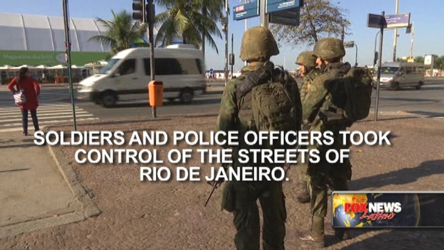 Soldiers and police officers took control of the streets of Rio de Janeiro, as part of the operation to bring security to the city hosting the Olympic Games.