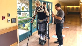 Robotic walking suit helps patients takes strides again