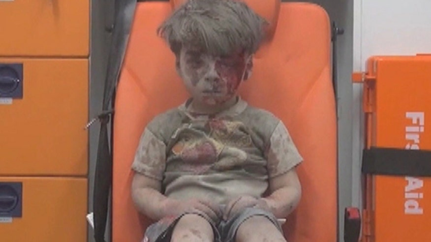 Haunting images of young boy rescued after air strike hit family's home in Aleppo, Syrian civil war all he's known