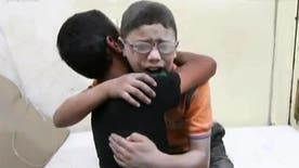 Heartbreaking video of two Syrian boys consoling each other, crying over brother killed in barrel bomb explosion, 15 people including 11 children died in the blast
