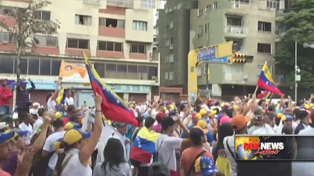 Venezuelans flood streets demanding Maduro's recall