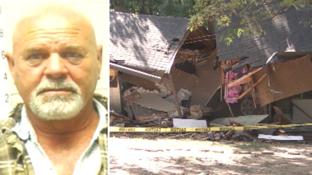 Feud allegedly leads to man bulldozing neighbor's home