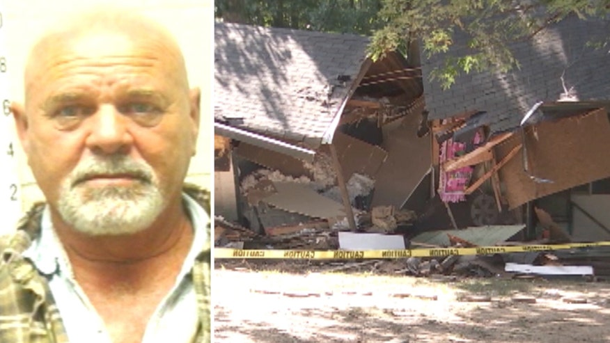 Tennessee man accused of using backhoe to damage house