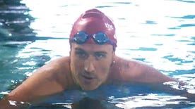 Disgraced Olympian swims in charity race