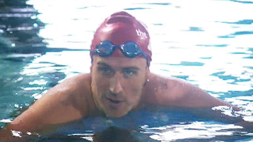 Disgraced Olympian swims in charity race