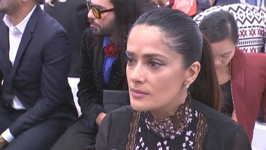"Actress Salma Hayek, speaking before Monday's Giambattista Valli fashion show, described the incident as ""horrific""."