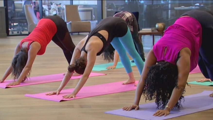 """If you don't have time to hit the gym a new app called """"Easypose"""" is making it simple. The app sends a yoga instructor right to your office for group classes with your coworkers"""