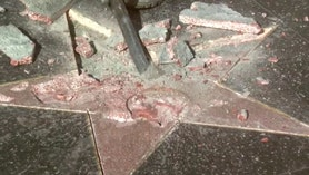 Raw video: Workers replace marker after vandal used hammer, pickax in pre-dawn attack on reality TV personality-turned-presidential nominee's star in Hollywood