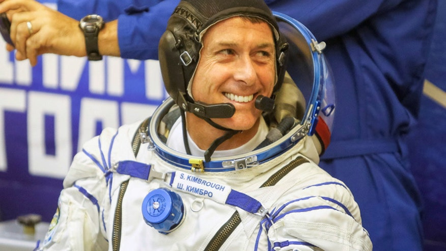 NASA astronaut Shane Kimbrough, the lone American aboard the International Space Station, casts his vote for presidential election from outer space