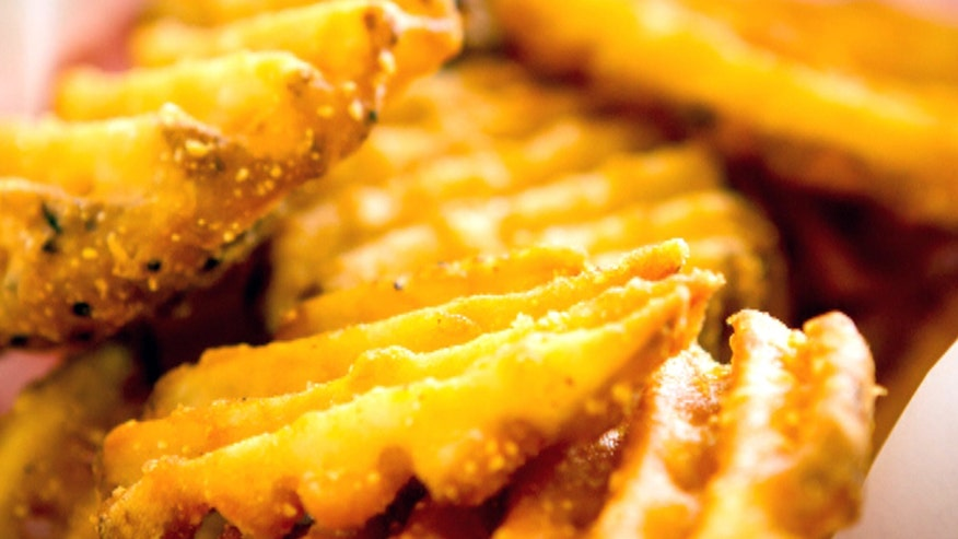 McDonald's Canadian locations now serving waffle fries during holiday season. Israeli Burger Kings opt for doughnut burgers during Hanukkah