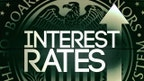 The Federal Reserve raises its key interest rate a quarter percent, the first hike in a year and only the second since 2006