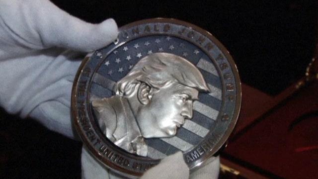 Russian company creates 'In Trump We Trust' coin