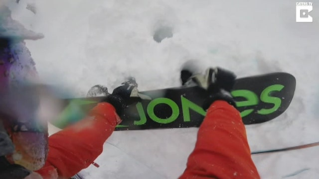 Race against time to rescue buried snowboarder