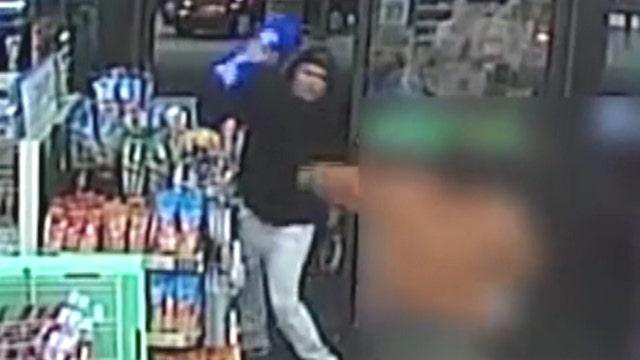 Thieves throw case of beer at store clerk