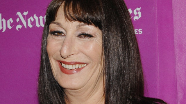 What Does Anjelica Huston Sing in the Shower?