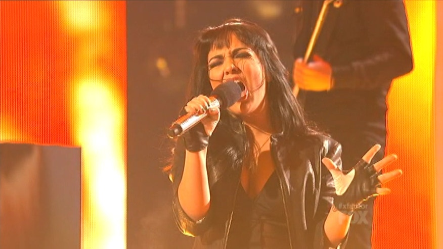 "Jennel Garcia loves rock and roll and Wednesday night on ""The X Factor"" she proved she's a rock star."